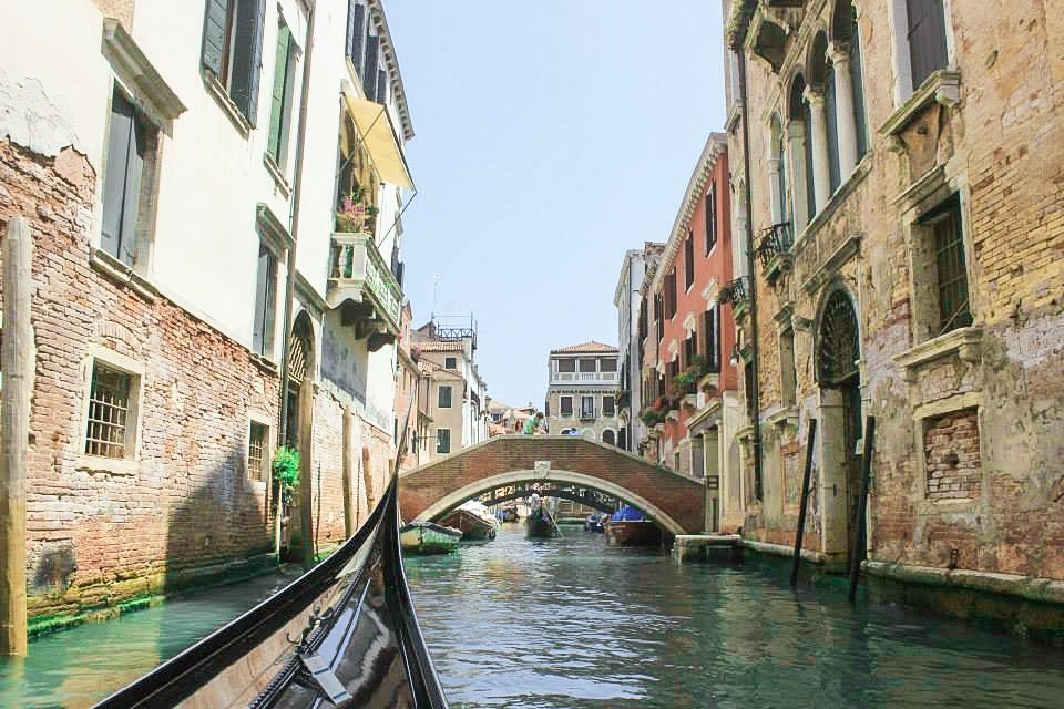 riding on a gondola in Venice, Italy